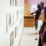 Women admires exhibit at Cook Library Center